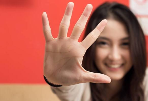Girl Pressing Hand Against Glass