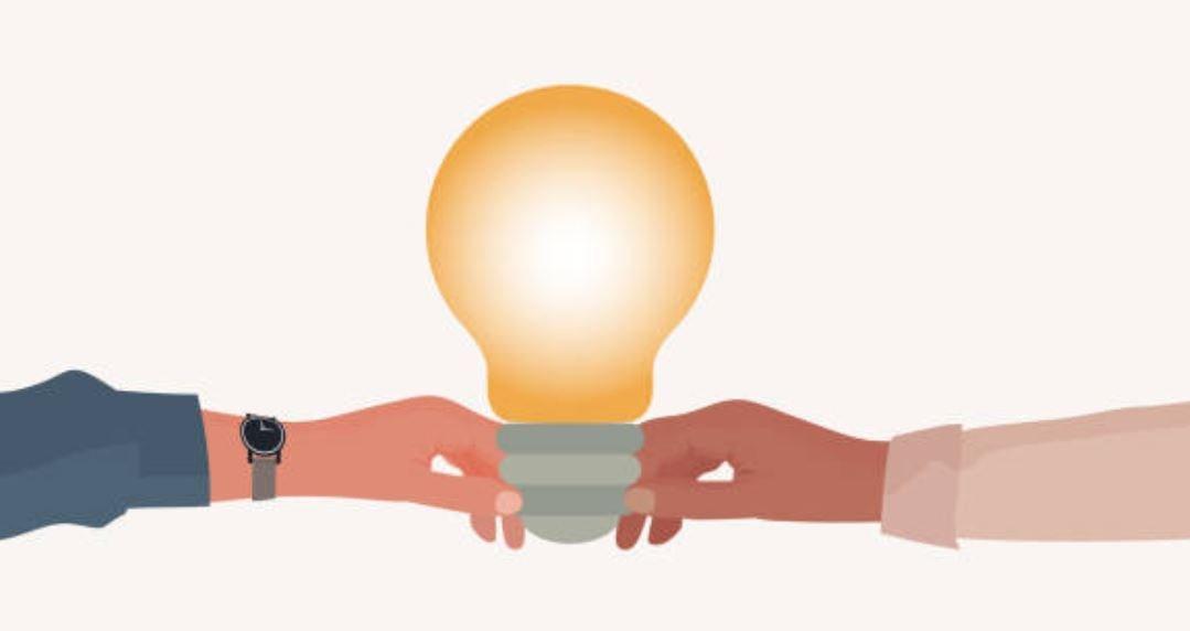 Couple holding lightbulb
